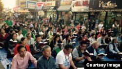 Tibetans in NY gathered to pray for the quake victims.