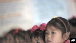 North Korean orphans during a visit from a foreign delegation at their orphanage in the area damaged by recent floods and typhoons in North Hwanghae province September 29, 2011.