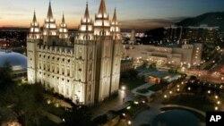 The sun sets behind the Mormon Temple in Salt Lake City, Utah. (AP Photo/Douglas C. Pizac)
