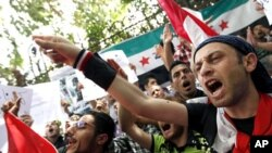 Demonstrators chant slogans during a protest demanding the ouster of the Syrian government, in front of the Syrian embassy in Cairo April 26, 2011