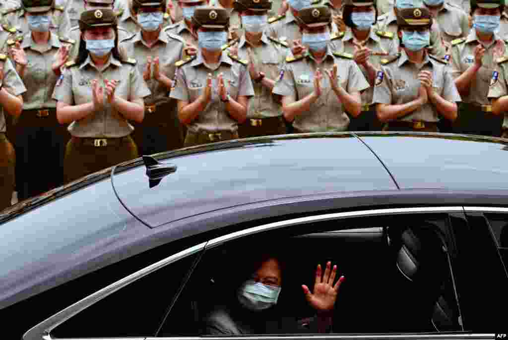 Taiwan President Tsai Ing-wen waves after inspecting the military police headquarters in Taipei.