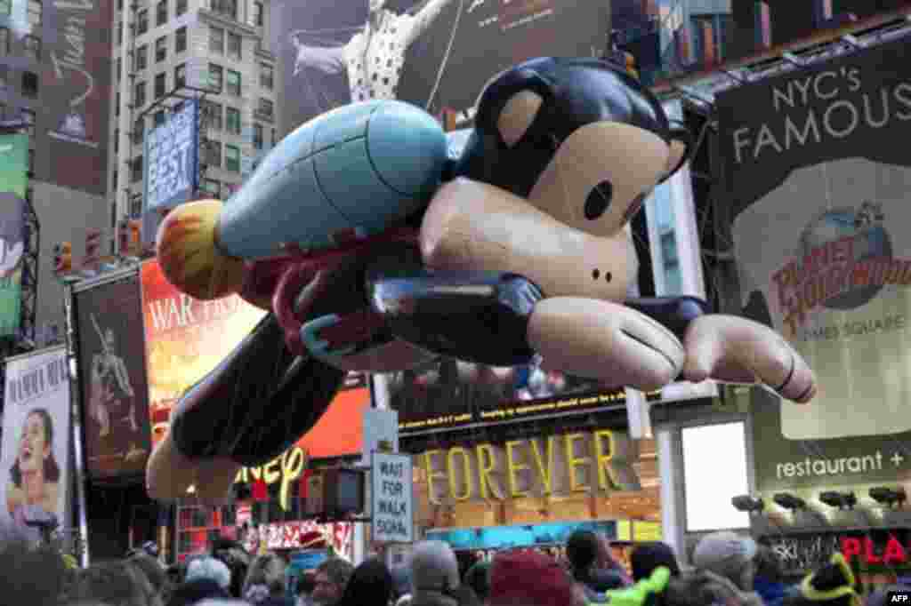 Julius, a jetpack-wearing monkey made by Paul Frank is seen during the Macy's Thanksgiving Day Parade in Times Square in New York on Thursday, Nov. 24, 2011. The parade premiered in 1924, this is its 85th year. (AP Photo/Andrew Burton)