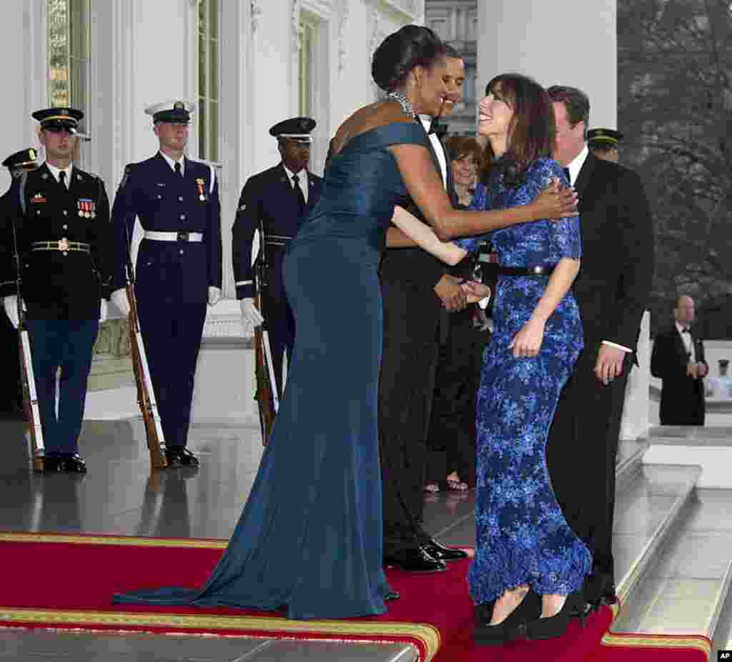 President Obama and Mrs. Obama welcome Prime Minister Cameron and Mrs. Cameron for a State Dinner. (AP)