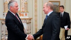 Vladimir Putin, at the time Russian Prime Minister, meets with Rex W. Tillerson, chairman and chief executive officer of Exxon Mobil Corporation.