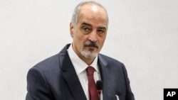 Head of the Syrian government delegation Bashar al-Ja'afari is seen at a meeting during Syrian peace talks at the European headquarters of the United Nations in Geneva, Switzerland, Dec. 14, 2017.