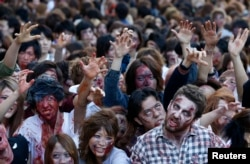 "Zombies are also commonly seen at Halloween. Here, people dress as zombies during a Halloween event to promote the show ""The Walking Dead"" in Tokyo October 2013."