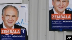 Campaign posters of Health Minister Marian Zembala of the ruling pro-business Civic Platform in Katowice, Poland, Monday, Oct. 19, 2015.