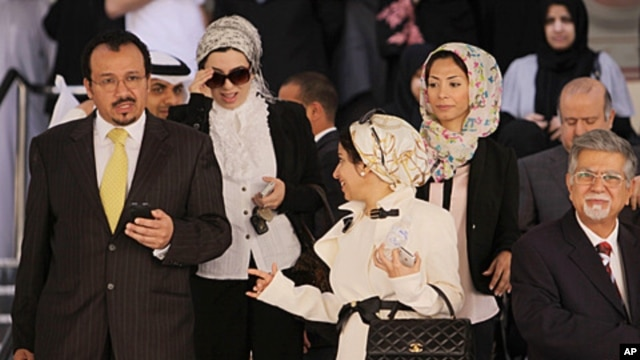 Dr. Ali al-Ekri, left, Dr. Nada Dhaif, center, Dr. Fatima Haji, 3rd right, and Dr. Saeed Samaheeji, right, leave the Manama, Bahrain, courthouse  after a trial session appealing security court convictions and sentences against them and other medics, Janua