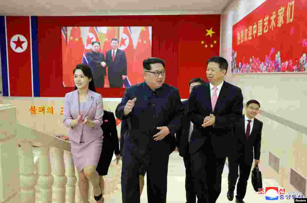 North Korean leader Kim Jong Un meets Song Tao, the head of the China's Communist Party's International Department who led a Chinese art troupe to North Korea for the April Spring Friendship Art Festival, in this handout photo released by North Korea's Ko