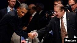 نواز شریف، صدراعظم پاکستان در جریان نشست بین المللی اتمی با باراک اوباما، رئیس جمهور امریکا در هالگ دیدن کرد.