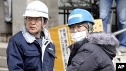 Workers transport products at Sony's tsunami-crippled warehouse near Sendai port, March 23, 2011
