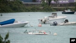 Swamped boats sit in Mullet Bay after the passing of Hurricane Nicole in St. Georges, Bermuda, Oct. 13, 2016. Hurricane Nicole roared across Bermuda, pummeling the resort island with winds that snapped trees and peeled off roofs before the storm spun away out to sea.