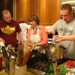 Judy Harris helps Danny Becker, left, and Jeff Van Meter make a Thai shrimp curry