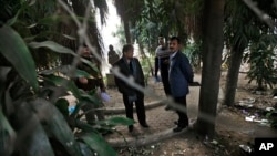 Indian investigators visit a spot which police say is where a Danish tourist was gang-raped in New Delhi, Jan. 15, 2014.