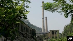 FILE - Ninh Binh Power Plant, which is a coal fired power plant to supply electricity, is seen in Ninh Binh Province in Vietnam, Sept. 19, 2007. The Asian Development Bank agreed Friday to loan Vietnam nearly $1 billion to build a coal-fired power plant as the booming country scrambles to keep up with its surging demand for power.