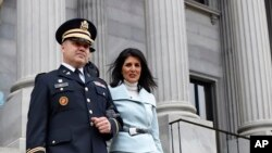 South Carolina Gov. Nikki Haley, seen in this Jan. 14, 2015 file photo, is escorted down the steps of the Capitol by her husband Michael, in Columbia, S.C. President-elect Donald Trump has chosen Haley as U.S. ambassador to the United Nations, the first woman tapped for a top-level administration post during his White House transition so far.