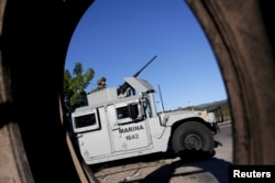 "A soldier mans his machine gun atop an armored vehicle in a checkpoint at the hometown of Joaquin ""El Chapo"" Guzman in the municipality of Badiraguato, in Sinaloa state, Mexico, Jan. 9, 2016."