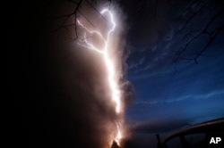 Lightning flashes as Taal Volcano erupts Sunday Jan. 12, 2020, in Tagaytay, Cavite province, outside Manila, Philippines.