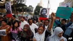 Activists of Pakistan civil society rally to condemn the missing of human rights activist Salman Haider, in Karachi, Pakistan, Jan. 9, 2017.