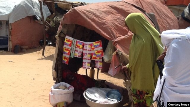 A small, woman-run store at the Hidaya Camp, on the outskirts of Mogadishu, sells detergent, coffee, charcoal and candy. (Photo courtesy of Filsan Darman)