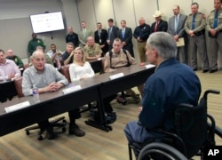 Secretary of Homeland Security John Kelly, left, talks with Texas Governor Greg Abbott, right