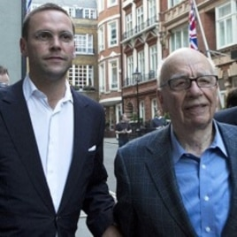 James and Rupert Murdoch (C) and a minder leave the Stafford Hotel in St James's Place, central London July 10, 2011.