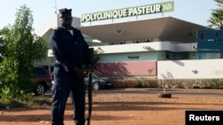 A police officer stands guard outside the quarantined Pasteur Clinic in , Nov. 12, 2014. The government of Mali confirmed the country's second case of Ebola late on Tuesday and police were deployed outside the clinic in the capital, Bamako, that authorities said had been quarantined.