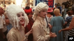 Bigwigs are worn for Bastille Day celebration in New York on July 13, 1997. (AP File photo)