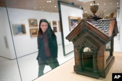 This Wednesday, Jan. 9, 2019, photo shows a British Edwardian-style Dog House for a Chihuahua on display at the American Kennel Club Museum of the Dog in New York. The museum opens Feb. 8. (AP Photo/Mary Altaffer)