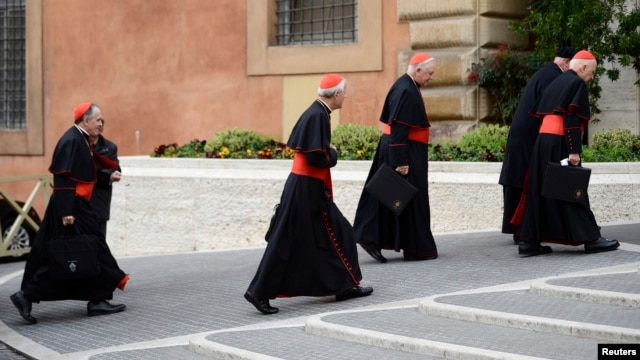 U.S. Cardinals (L-R) Daniel  Di Nardo, Donald Wuerl, William Levada, and Francis George arrive for a meeting in the Synod Hall at the Vatican, Mar. 8, 2013.