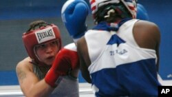 FILE - Reigning champion Patricia Manuel, of Commerce, Calif., competes in a 132-pound division at the 2010 USA boxing national championships, July 15, 2010, in Colorado Springs, Colo. Saturday night, Manuel, a transgender male, won his first professional bout.