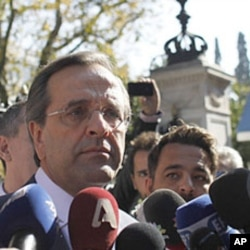 Antonis Samaras addresses the media after meeting Greek president Karolos Papoulias, at the Presidential Palace in Athens, November 6 2011.