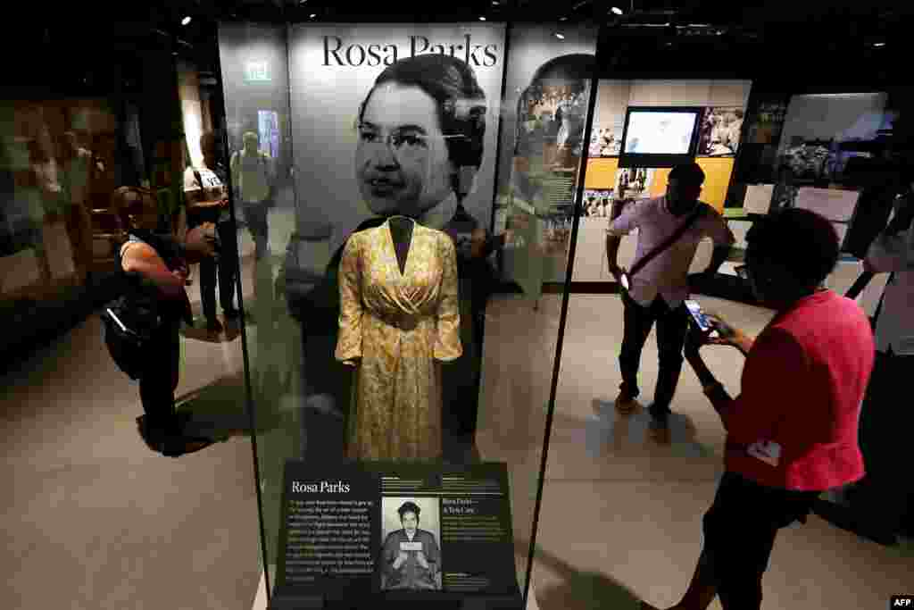 Civil Rights pioneer Rosa Parks' dress is on display in the concourse galleries at the Smithsonian's National Museum of African American History and Culture on the National Mall Sept. 14, 2016 in Washington.