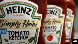 FILE - One of the most familiar products made by H.J. Heinz Co.is its signature ketchup.
