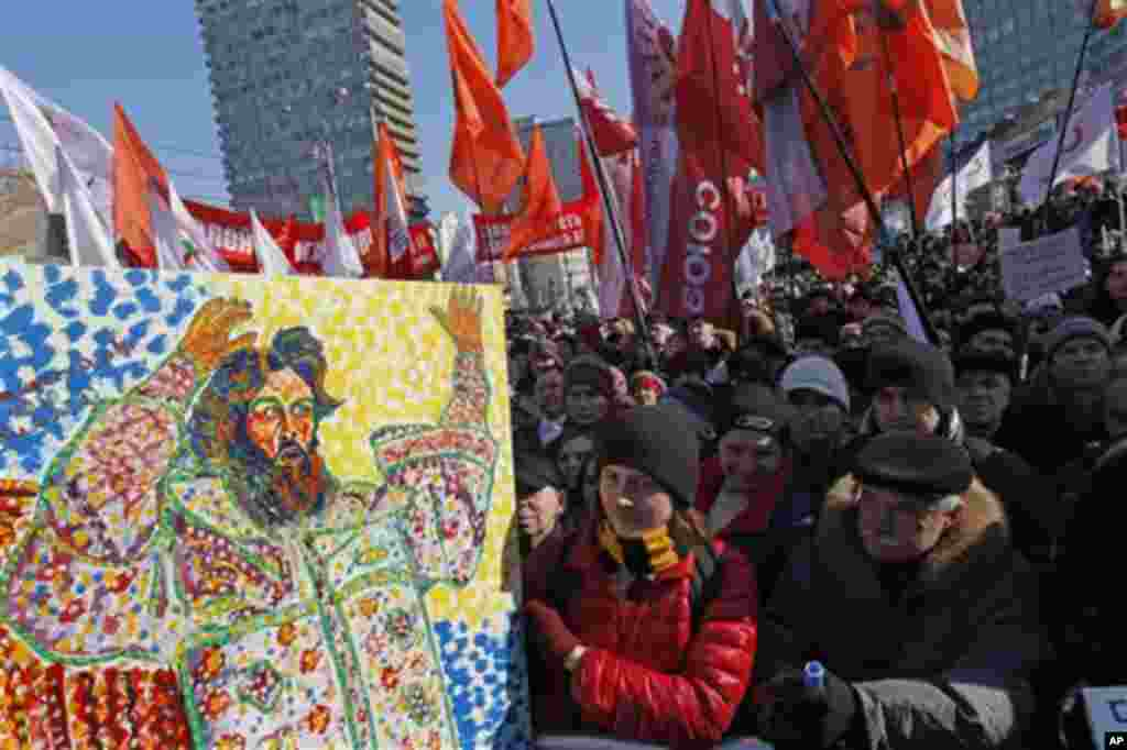 Opposition protesters with a placard depicting Czar Ivan The Terrible gathered during a rally in Moscow, Russia, Saturday, March 10, 2012. The demonstrators gathered in central Moscow to protest electoral fraud. Saturday's rally is widely seen as evidence