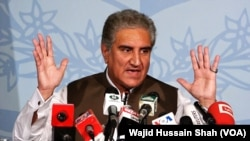 FILE - Pakistani Foreign Minister Shah Mehmood Qureshi speaks during a news conference in Islamabad, Aug. 24, 2018.