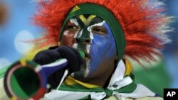 A South African soccer fan blows a vuvuzela in Pretoria during World Cup play, June 16, 2010