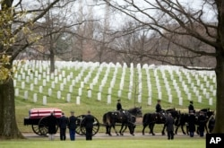 A funeral procession at Arlington National Cemetary.