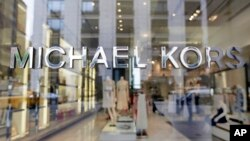 FILE- Michael Kors name adorns his store on Madison Avenue, in New York, May 31, 2017.