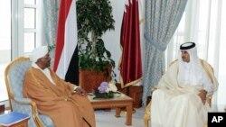 In this handout photo from Qatar News Agency, Sudanese President Omar al-Bashir, center left, meets with with Qatar's ruling emir, Sheikh Tamim bin Hamad Al Thani, in Doha Qatar, Jan. 23, 2019.