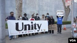 Community members take part in a protest to raise awareness of anti-Asian violence and racist attitudes, outside the Hall of Justice, San Francisco, March 4, 2021.
