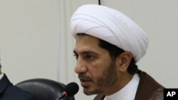 FILE - Sheikh Ali Salman, now on trial for allegedly advocating an overthrow of the Bahrain regime, speaks at a news conference in Umm Al Hassam, Bahrain, Feb. 15, 2012.