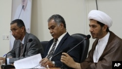 Opposition leaders (from left to right) Mahmood al-Rajab, Radhi Mohsen al-Mosawi and Sheikh Ali Salman speak at a joint press conference in Umm Al Hassam, Bahrain, February 15, 2012.