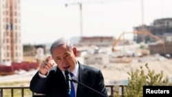 FILE - Israeli Prime Minister Benjamin Netanyahu delivers a statement in front of a new construction, in the Jewish settlement known to Israelis as Har Homa and to Palestinians as Jabal Abu Ghneim, March 16, 2015
