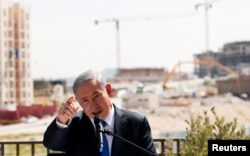Israeli Prime Minister Benjamin Netanyahu delivers a statement in front of a new construction, in the Jewish settlement known to Israelis as Har Homa and to Palestinians as Jabal Abu Ghneim, March 16, 2015