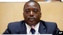 FILE - Democratic Republic Congo's President Joseph Kabila attends a meeting at the African Union Headquarters in Addis Ababa, Ethiopia, Feb. 24, 2013. Talks started Dec. 13, 2016, to decide who will run the country after Kabila's second term ends Dec. 19, 2016.