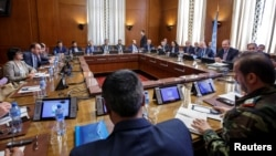 Syria's main opposition High Negotiations Committee leader Naser al-Hariri and UN Special Envoy of the Secretary-General for Syria Staffan de Mistura attend a round of negotiation, during the Intra Syria talks, at the European headquarters of the United Nations in Geneva, Switzerland, May 16, 2017.