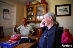 Farmer Dick Smith reacts as he sits with his wife, Sue, at their home, located near the outback town of Stonehenge, in Queensland, Australia, Aug. 12, 2017.