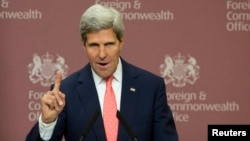 U.S. Secretary of State John Kerry gestures during his joint news conference with Britain's Foreign Secretary William Hague in London, Sept. 9, 2013.