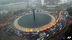 FILE - A traffic jam during heavy rain at the main roundabout in Jakarta, Indonesia.